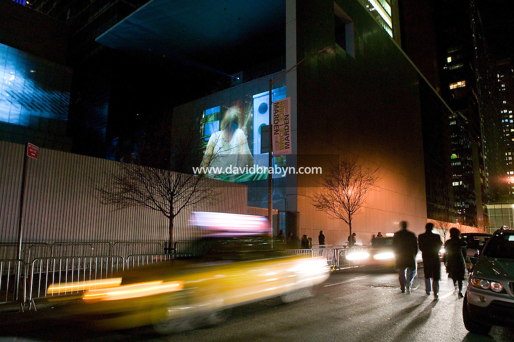 16 January 2007 - New York City, NY - People attend the opening of Doug Aitken's month-long show Sleepwalkers at the museum of Modern Art in New York City, USA, 16 January 2007. The artwork consists of eight large-scale moving images projected onto the exterior of MoMA.