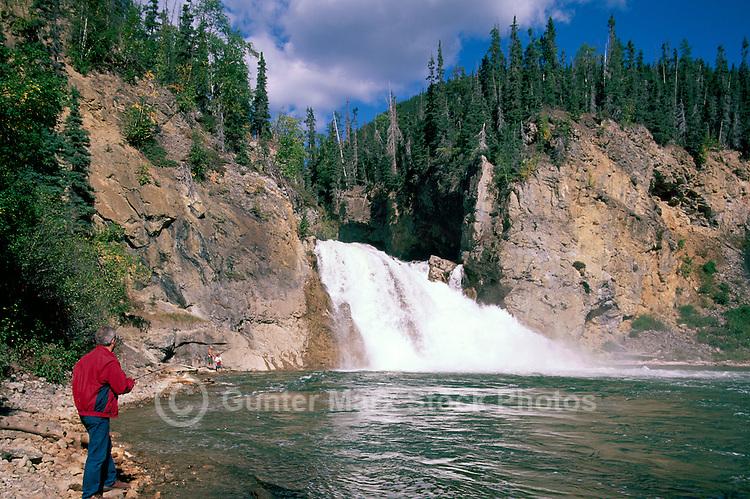 Sports Fisherman fishing at Smith River Falls, Northern BC, British Columbia, Canada - along Alaska Highway