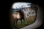 Travel scenes of Wyoming through the window of a rented Mazda M5...A sign welcoming passersby to Colorado on the state line of Wyoming and Colorado.
