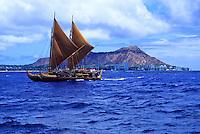 Historic Polynesian voyaging canoe, Hokule'a, sails offshore (Diamond Head) of Honolulu, Oahu, Hawaii