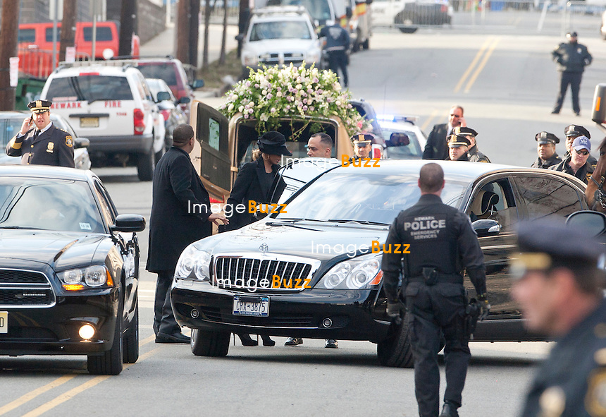 NEWARK, NJ - FEBRUARY 18 :  Family members and guests attend the Whitney Houston's funerals at 'The New Hope Baptist Church' on February 18, 2012 in Newark, New Jersey. Whitney Houston was found dead in her hotel room at The Beverly Hilton hotel on February 11, 2012. .Pic :  Mary J. Blige and husband.................