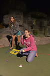 Freeport, New York, U.S. September 6, 2013. Cousins ALIYA SIDER, 15, in pink top, and BRITTNEY SCANNELL, 17, in gray top, both from Baldwin, play a night game of miniature golf at Crow's Nest Mini Golf at the Nautical Mile.