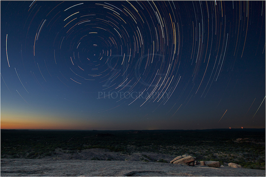 I spent a few hours on top of the Texas Hill Country at Enchanted Rock to photograph stars as they circled the north star. This image is comprised of about 150 30-second exposures in order to show the star trails as they drift through the night sky.