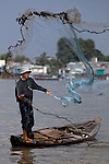 Sa, 45, casts a net out for fish on the Hau Giang River, a tributary of the Mekong River, in Chau Doc, in the An Giang Province, Vietnam. When the Mekong River reaches Vietnam it splits into two smaller riveres. The &quot;Tien Giang&quot;, which means &quot;upper river&quot; and the &quot;Hau Giang&quot;, which means &quot;lower river&quot;. Photo taken on Monday, December 7, 2009. Kevin German / Luceo Images