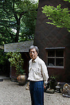 Shizuoka prefecture, Japan, July 9 2014 - Portrait of former prime minister Morihiro Hosokawa in front of his atelier, built with his friend, Japanses architecte Terunobu Fujimori. Mr Hosokawa started ceramics art after he retired from politics.