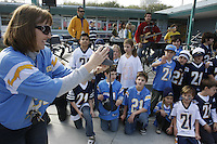 Silver Gate Elementary Principal Sandy McClure videotapes students dressed in San Diego Chargers regalia for a rally on campus in advance of this weekends playoff game, Friday January 11 2008
