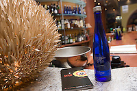 """Quebec city, August 1, 2008 - A """"cultural champaign"""" Largo water bottle lies on a counter at Largo restaurant on St-Joseph street in Quebec city."""