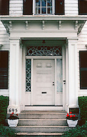 "New Bedford:  Bracketed house--porch detail. 695 County St.  A plaque reads   ""1850 Sarah Willis Reed"".  Photo '91."