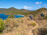 Ram Head hike looking west towards Salt Pond Bay.with hikers and Estate Concordia in the distance.St. John, U.S. Virgin Islands