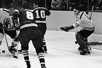 Boston Bruins Bobby Orr, keeps puck from Seals Gerry Ehman and Ted Hampson, Bruin goalie Eddie Johnston. (1970 photo/Ron Riesterer)