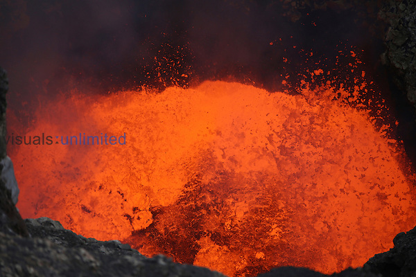 Vigorously churning and degassing molten lava lake in bottom of Santiago Crater of erupting Masaya Volcano, Nicaragua