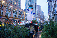 Christmas trees and decorations for sale in the Chelsea neighborhood of New York on Saturday, December 6, 2014. According to the American Christmas Tree Association last year Americans displayed over 94 million trees in their homes.  (© Richard B. Levine)