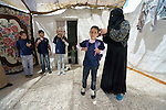 Rufiedah, who asked that her last name not be used for security reasons, prepares her children to walk to school in Madaba, a sprawling Palestinian refugee camp in Jordan that has grown in recent years with the arrival of women like Rufiedah, who came to Madaba in 2014 from a village near Damascus, Syria. As a result, the more than 25,000 Palestinians in Madaba have been joined by more than 12,000 Syrians. The  Department of Service for Palestinian Refugees of the Middle East Council of Churches, a member of the ACT Alliance, provides a variety of services here, including medical care.