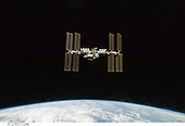 In Earth Orbit - July 28, 2009 -- Backdropped by Earth's horizon and the blackness of space, the International Space Station is seen from Space Shuttle Endeavour as the two spacecraft begin their relative separation. Earlier the STS-127 and Expedition 20 crews concluded 11 days of cooperative work onboard the shuttle and station. Undocking of the two spacecraft occurred at 12:26 p.m. (CDT) on July 28, 2009..Credit:  NASA via CNP