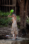 Son, 12, bathes himself in the Hau Giang River, a tributary of the Mekong River, in Chau Doc, in the An Giang Province, Vietnam. When the Mekong River reaches Vietnam it splits into two smaller riveres. The &quot;Tien Giang&quot;, which means &quot;upper river&quot; and the &quot;Hau Giang&quot;, which means &quot;lower river&quot;. Photo taken on Monday, December 7, 2009. Kevin German / Luceo Images
