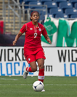 Canadian defender  Candace Chapman (9) dribbles. In an international friendly, Canada defeated Brasil, 2-1, at Gillette Stadium on March 24, 2012.