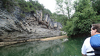 NWA Democrat-Gazette/FLIP PUTTHOFF <br /> Paddlers drift by an occasional      Sept. 15 2015          tall bluff on the War Eagle River.