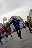 Moscow, Russia<br /> September 13, 2009<br /> <br /> A man hops to the beat during a dance festival on Manezhnaya Square near the Kremlin.