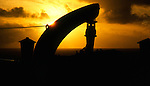 Lifeboat davit and winch against setting sun on board a ship.. Atlantic ocean.