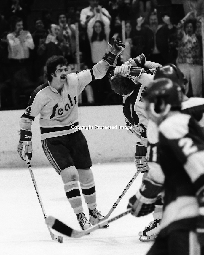 Seals Pete Laframboise and Stan Weir celebrate goal against the Minnesota Noirth Strars. (1973 photo by Ron Riesterer)
