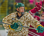 25 November 2014: University of Vermont Catamount Defenseman Michael Paliotta, a Senior from Westport, CT, in action against the University of Massachusetts Minutemen at Gutterson Fieldhouse in Burlington, Vermont. The Cats defeated the Minutemen 3-1 to sweep the 2-game, home-and-away Hockey East Series. The 12th ranked Catamounts wore their camouflage uniforms for the evening to honor the US military. Mandatory Credit: Ed Wolfstein Photo *** RAW (NEF) Image File Available ***