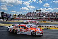 May 6, 2012; Commerce, GA, USA: NHRA pro stock driver Jason Line (near) races alongside Ronnie Humphrie during the Southern Nationals at Atlanta Dragway. Mandatory Credit: Mark J. Rebilas-