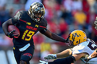 College Park, MD - OCT 15, 2016: Maryland Terrapins wide receiver Teldrick Morgan (19) stiff arms Minnesota Golden Gophers defensive lineman Yoshoub Timms (52) during game between Maryland and Minnesota at Capital One Field at Maryland Stadium in College Park, MD. (Photo by Phil Peters/Media Images International)