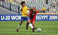 Germany's Lewis Holtby (10) tangles with Brazil's Dalton (3) during the FIFA Under 20 World Cup Quarter-final match at the Cairo International Stadium in Cairo, Egypt, on October 10, 2009. Germany lost 2-1 in overtime play.