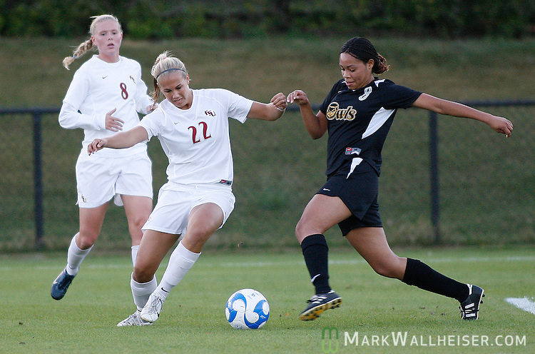FSU's Margo McAuley (22) battles Kennesaw State's Sadjr Williams in the first half of first round NCAA soccer action in Tallahassee November 16, 2007.(Mark Wallheiser/TallahasseeStock.com)
