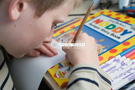 Boy with Autism practicing writing,