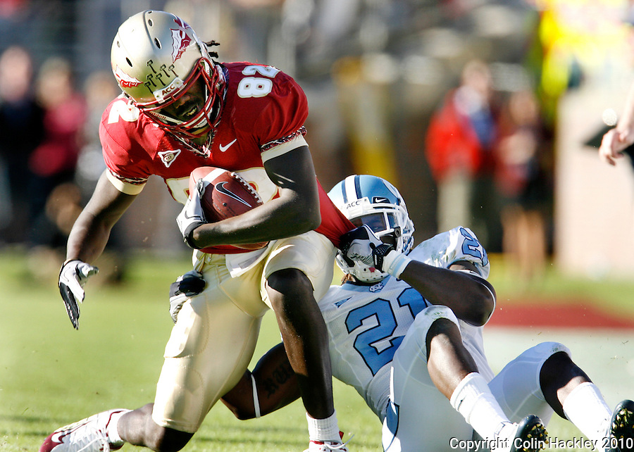 TALLAHASSEE, FL 11/6/10-FSU-NC FB10 CH-Florida State's Willie Haulstead is pulled down by North Carolina's Da'Norris Searcy during first half action Saturday at Doak Campbell Stadium in Tallahassee. The Tar Heels beat the Seminoles 37-35. .COLIN HACKLEY PHOTO