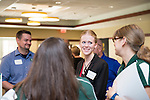 Tasha Gardone talks to Jennie Daniels at the Campus Communicator Network Expo in Nelson Commons on Wednesday, May 11, 2016. © Ohio University / Photo by Kaitlin Owens