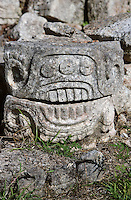 """Carved, bas-relief glyph, western façade of the Codz Poop (""""Rolled-up matting"""" in Maya), Puuc Architecture, 700 ? 900 AD, Kabah, Yucatan, Mexico. Picture by Manuel Cohen"""