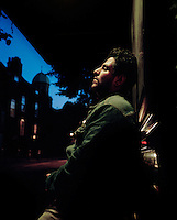 28 year old Hamid from Iran sits at a bus stop in North London. He spent three years living on buses, in parks and on the streets of London, using heroin to self-medicate the after effects of being tortured in prison for over a year in his homeland. Hamid's father ran a large and successful building and car business in Iran, the family was wealthy and after leaving school he worked for his father. He became involved in a political movement that opposed the government and as a result was detained and tortured. Hamid's brother was hanged due to his anti-government political activity. Hamid however managed to escape to the UK, and after his asylum claim was refused he became destitute and started sleeping rough. Hamid is one of an estimated 300,000 rejected asylum seekers living in the UK.