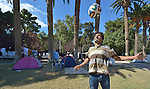 A refugee heads a football in the city park on the Greek island of Chios. The park is full of tents sheltering refugees who crossed the Aegean Sea in small boats from Turkey. They were registered and provided with food and shelter in a reception center built with support from International Orthodox Christian Charities, a member of the ACT Alliance. Many of them then move to the city park where they await a ferry to take them to Athens and then on toward western Europe. Hundreds of thousands of refugees and migrants have passed through Greece in 2015.