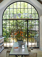 The showstopper in the kitchen is the 14-foot high arched steel window and door which opens into the garden