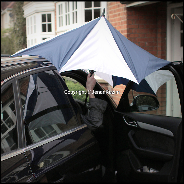 BNPS.co.uk (01202 558833)<br /> Pic: JenanKazim/BNPS<br /> <br /> ***Please Use Full Byline***<br /> <br /> An umbrella is hard work when trying to get into your car. <br /> <br /> <br /> Inventor Jenan Kazim is turning world of the humble brollie inside out - after designing one that folds inwards to stop water dripping onto the floor.<br /> <br /> Rather than creating pools of rainwater on the floor when it is put away like standard umbrellas, Jenan's clever idea folds the opposite way collecting drips inside it.<br /> <br /> And thanks to its canny design which opens from the top rather than the bottom it puts paid to the age-old problem of poking passers-by in the head with brolly spokes.<br /> <br /> It also means users can stay dry for longer by putting their umbrellas down once they are sat inside their cars rather than before. <br /> <br /> The umbrella, which has been named the KAZbrella, will cost around 45 pounds when it is launched just in time for Britain's notoriously wet winter.