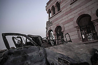 A car wreckage remains outside a mosque shattered during rough days of battles between rebel forces and the Syrian army to take control of the Azaz city.