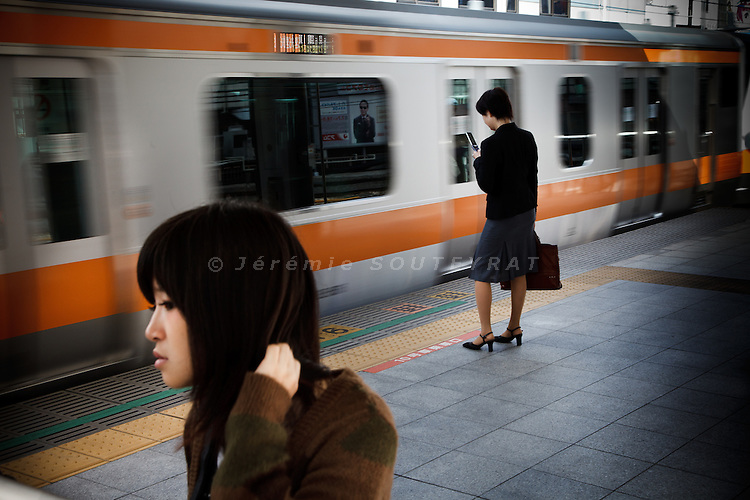 Tokyo, October 25 2011 - In the morning at Shinjuku train station.