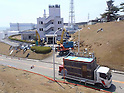 April 28, 2011, Okumamachi, Japan - A remote-controlled heavy machines remove debris at former Welfare Building in Fukushima No.1 Nuclear Power Plant in Okumamachi, Fukushima Prefecture, some 200km northeast of Tokyo, on April 13, 2011. The picture was release by Tokyo Electric Power Co., the operator of the crippled plant, on Thursday, April 28, 2011. (Photo by TEPCO/AFLO) [0006] -mis-