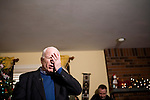 Sen. John McCain (R-AZ) campaigns at a house party in Londonderry, NH, on Monday, Dec. 31, 2007.