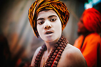 A boy who was initiated as a Naga at a very young age. Mostly, these young boys who end up being a Naga are orphans or kids who ran away from home...Kumbh Mela, 2010, Haridwar, Uttarakhand.