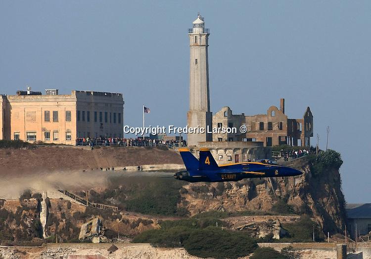The U.S Navy Blue Angels fly by Alcatraz Island in the San Francisco Bay, California.