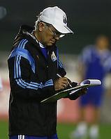 Argentina coach Alejandro Sabella makes notes on a tactics board