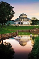 Frog pond and the Marjorie McNeely Conservatory  at Como Park in St. Paul, Minnesota at sunrise. The conservatory was first opened in 1915.