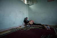 August 11, 2012 - Azaz, Aleppo, Syria: A syrian war refugee lays with her one day old son, Mohamad, in a improvised refugee center in Azaz, where 32 families who fled the combat areas are temporarily living. (Paulo Nunes dos Santos/Polaris)