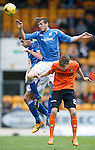 St Johnstone v Dundee United...26.09.15  SPFL   McDiarmid Park, Perth<br /> Murray Davdidson gets above Blair Spittal<br /> Picture by Graeme Hart.<br /> Copyright Perthshire Picture Agency<br /> Tel: 01738 623350  Mobile: 07990 594431