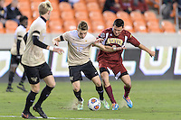 Houston, TX - Friday December 9, 2016: Brad Dunwell, (12) of the Wake Forest Demon Deacons and Sam Hamilton (8) of the Denver Pioneers battle for control of the ball at the NCAA Men's Soccer Semifinals at BBVA Compass Stadium in Houston Texas.