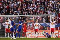 Jamison Olave (4) of the New York Red Bulls reacts to a foul call after Marvin Chavez (18) of the Colorado Rapids went down in the penalty box. The New York Red Bulls and the Colorado Rapids played to a 1-1 tie during a Major League Soccer (MLS) match at Red Bull Arena in Harrison, NJ, on March 15, 2014.