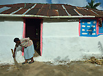 Cebonet Alcide sweeps the ground in front of her house in Despagne, an isolated village in southern Haiti where the Lutheran World Federation has been working with residents to improve their quality of life.